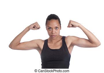 Beautiful african american woman flexing muscles