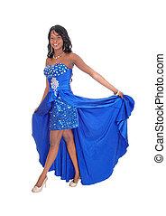 Beautiful African American woman in blue dress.