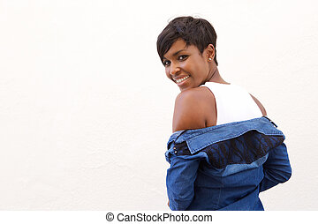 Beautiful african american woman looking over shoulder