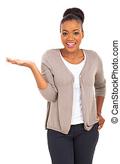 beautiful african american woman presenting on white background