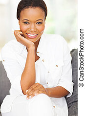 african american woman sitting at home