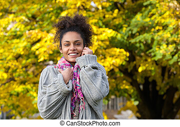 Beautiful african american woman smiling in autumn