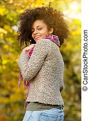 Beautiful african american woman smiling outdoors