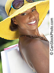 Beautiful African American Woman Smiling With Shopping Bags