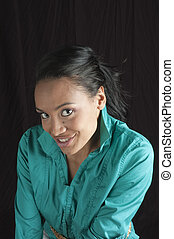 Beautiful african american woman smiling, sitting on stool