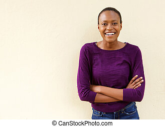 Beautiful african american woman smiling with arms crossed
