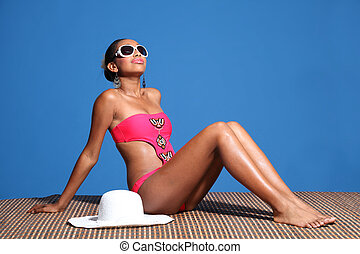 Beautiful african american woman sunbathing