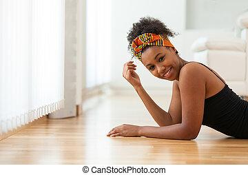 Beautiful African American woman wearing an african head scarf - Black people