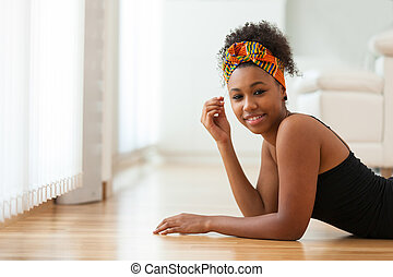 Beautiful African American woman wearing an african head scarf - Black people