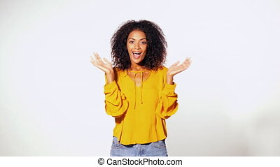Beautiful african american woman with afro hair in yellow...