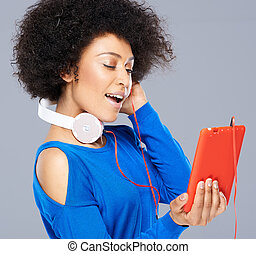 Beautiful African American woman with her music