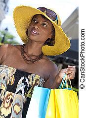 Beautiful African American Woman With Fashion Shopping Bags