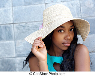 Beautiful african american woman with sun hat