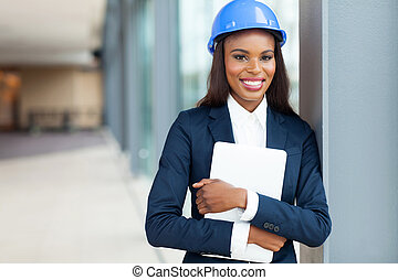 african construction engineer holding laptop computer