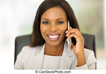 african corporate worker talking on mobile phone