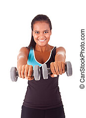 Beautiful african fitness woman working out with free weights