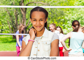 Beautiful African teen girl on the playground
