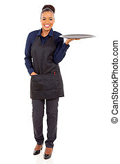 african waitress holding empty tray