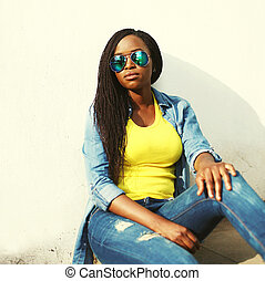 Beautiful african woman in colorful clothes and sunglasses