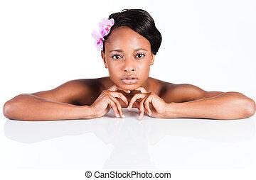 Beautiful African woman in Studio doing body care