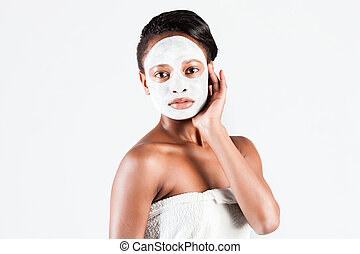 Beautiful African woman in Studio with facial mask