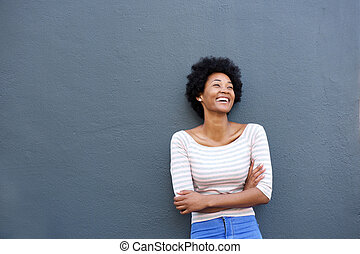 Beautiful african woman laughing and looking up