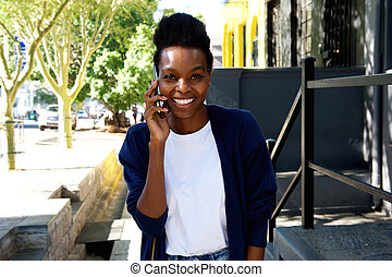 Beautiful african woman making a phone call
