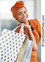 african woman shopping spree in mall