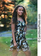 Beautiful african woman walking
