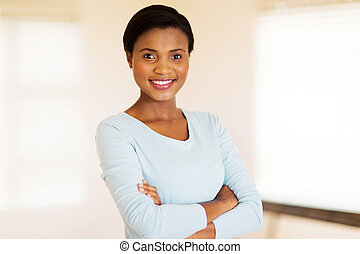 african woman with arms crossed