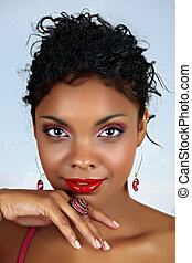 beautiful African woman with red lips and pink eyeshadow,...