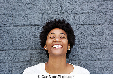 Beautiful african young woman laughing