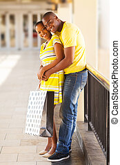 afro american couple hugging - beautiful afro american...