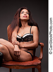beautiful afro-american model on an armchair
