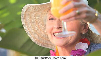 Beautiful aged woman celebrating