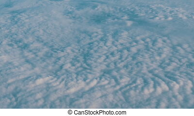 Beautiful air clouds float above ground. Aerial view from...