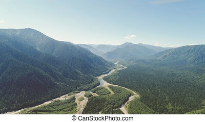 Beautiful air view on the river surrounded by green valleys...
