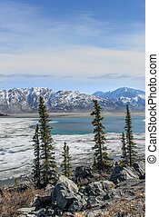 Beautiful Alaskan Landscape of a lake thawing in Springtime ...