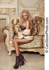 Beautiful alluring blond woman wearing sexy lingerie in fur...