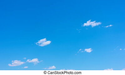Beautiful almost clear blue sky with light white clouds -...