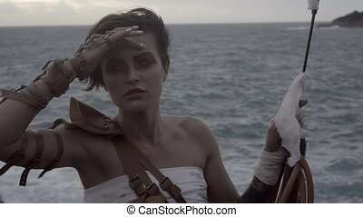 Beautiful amazon woman warrior - Closeup portrait video of...