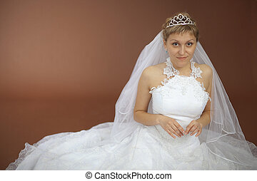 Beautiful amusing bride in white dress