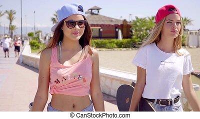 Beautiful and confident female friends near beach