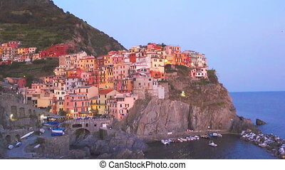 Beautiful and cozy village of Manarola in the Cinque Terre Reserve at sunset. Liguria region of Italy.