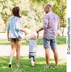 Beautiful and happy young couple having a great time with son