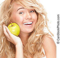 Beautiful and happy young woman with apple.