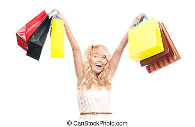 Beautiful and happy young woman with shopping bags.