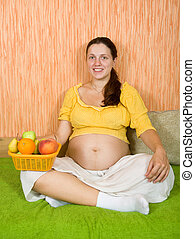 healthy pregnant woman with fruits