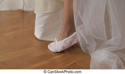 Beautiful and lovely bride in funny slippers. Close-up shot of woman legs