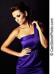 sexy brunette fashion girl in violet dress - portrait